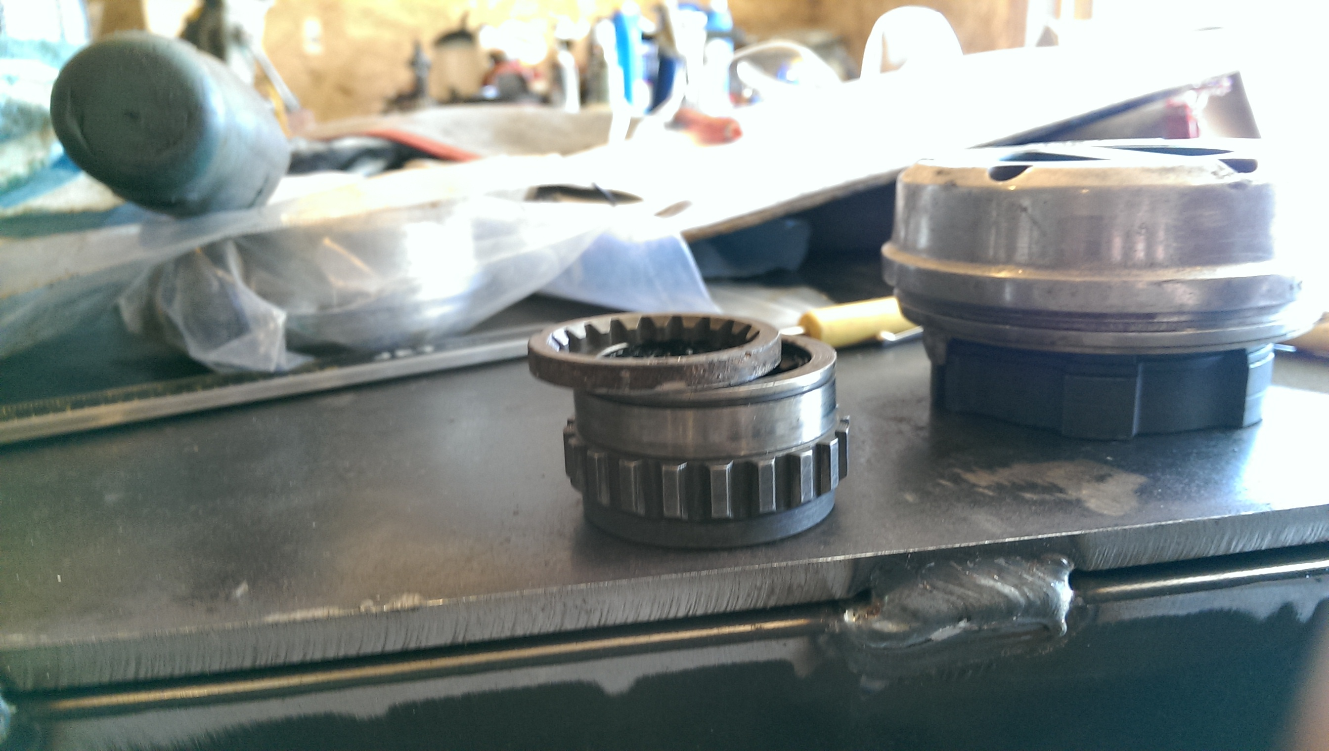 "the superwinch hubs i found at the junkyard for free (nice score on that) didnt fit my outter axles properly. there was about 1/8th inch space between the snap ring the axle lock. which allowed axle to slid back into contact with the inner ""c"". this is not good. so I used the 19spline sleeve from the old locks that I had to cut off from rust. I made a small spacer out of these as the superwinch hub lock has a special low profile snap ring so what ever spacer is used NEEDS to fit in the axle splines to not slide over top of the low profile snap ring"